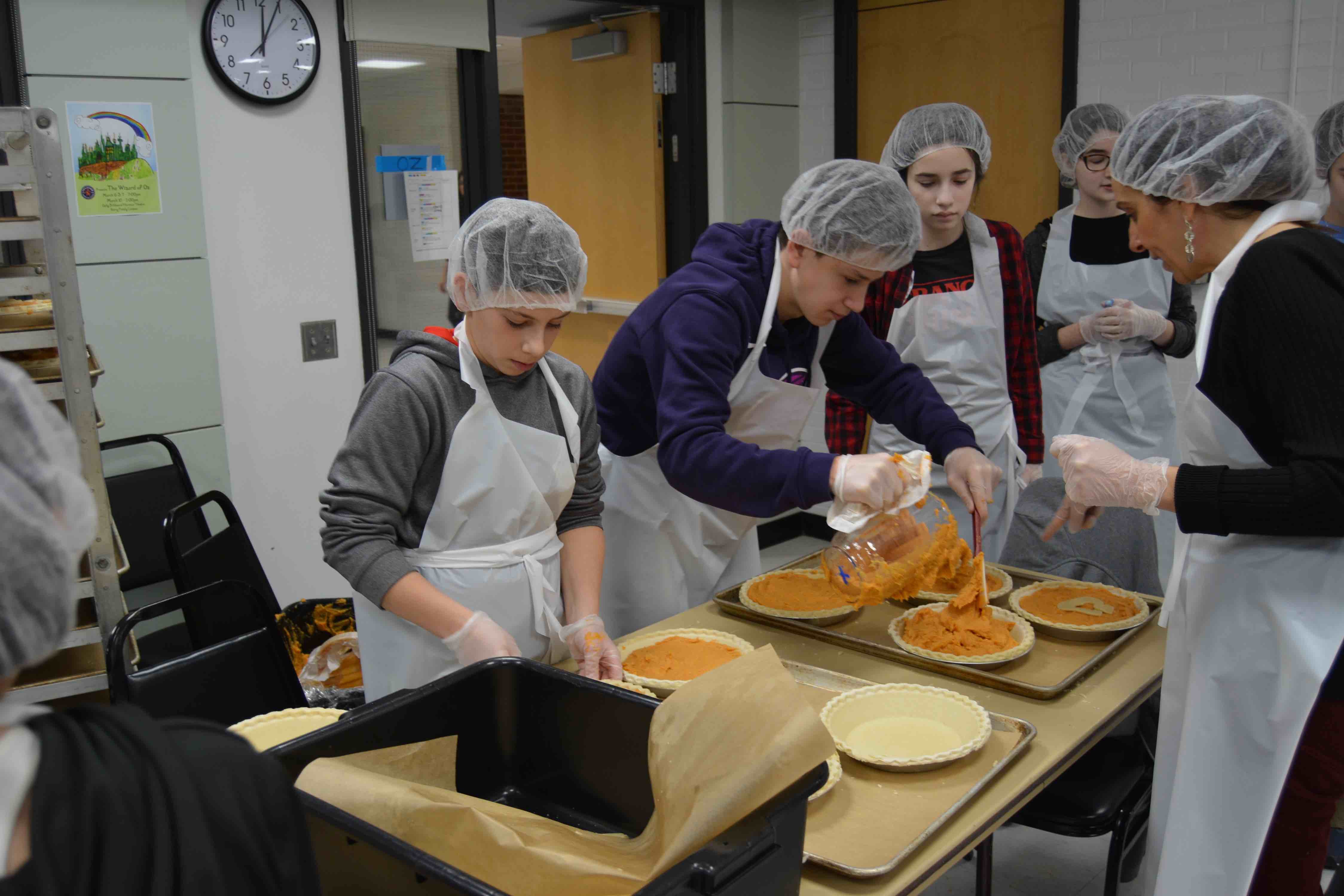 Students baking pies