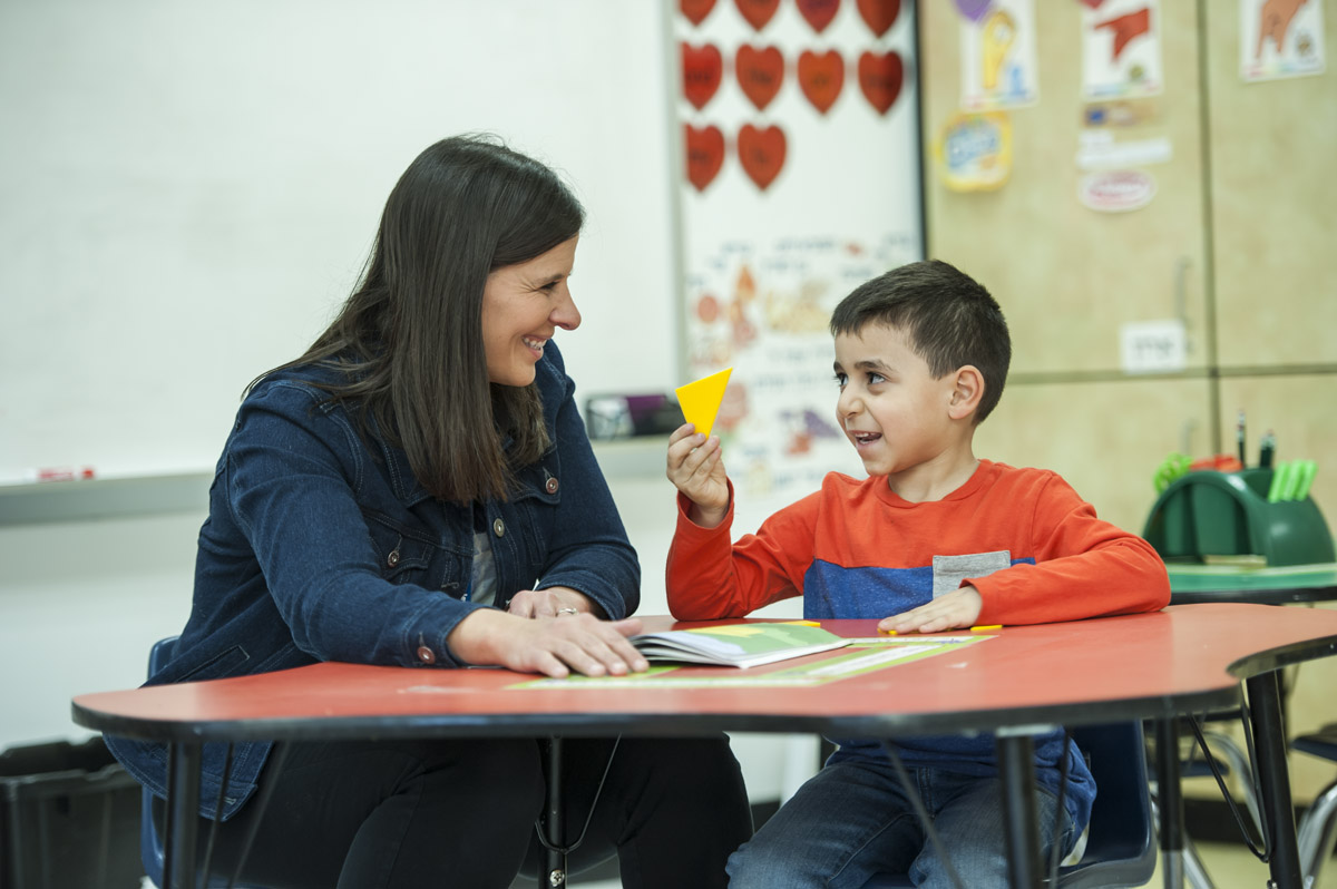 Teacher Jodi Danovsky works with a student on a math problem