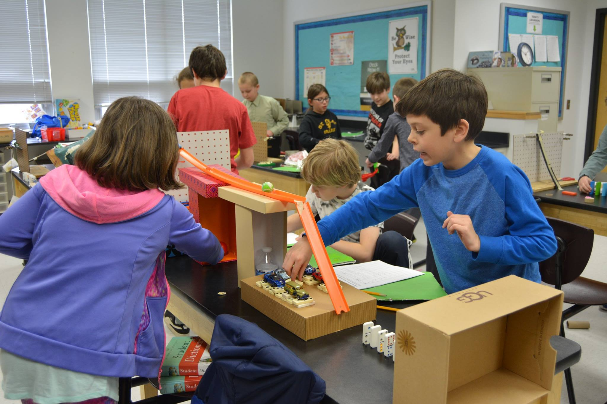 Students work with Rube Goldberg machines
