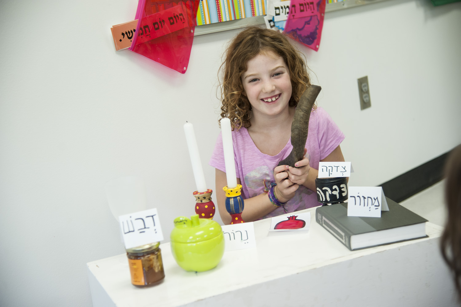 Student with ritual objects associated with Rosh Hashana